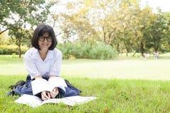 Schoolgirl was reading Stock Photography