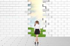 Schoolgirl watching dilapidated brick wall Stock Image