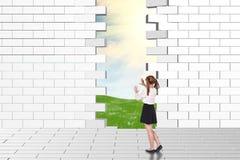 Schoolgirl watching dilapidated brick wall Royalty Free Stock Photos