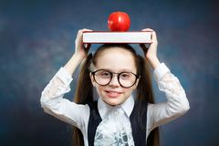 Schoolgirl Wear Glasses Carry Book Apple on Head stock photo