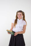 Schoolgirl in white blouse with glasses hate homework Royalty Free Stock Image