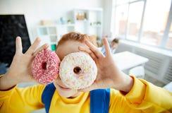 Free Schoolgirl With Donuts Stock Photo - 136542120