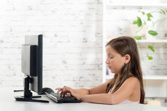 A schoolgirl working on a computer Royalty Free Stock Photo