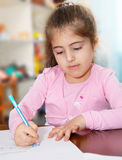 Schoolgirl works on her homework Stock Photography