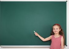 Schoolgirl write on school board Stock Photos