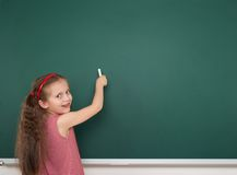 Schoolgirl write on school board Royalty Free Stock Photography
