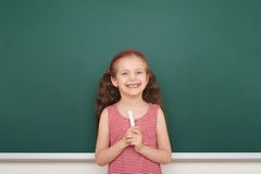 Schoolgirl write on school board Royalty Free Stock Images