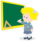Schoolgirl writes on the blackboard Stock Images