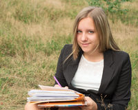 Schoolgirl writes in a notebook Stock Image
