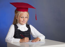 Schoolgirl writes Royalty Free Stock Photos