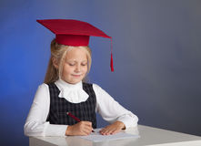 Schoolgirl writes Royalty Free Stock Photography