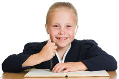 Schoolgirl writes at a table Stock Images
