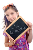 Schoolgirl writing back to school Stock Images