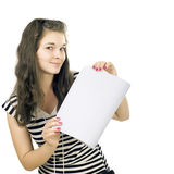 Schoolgirl and a writing-book. The schoolgirl has control over an open writing-book. Isolated white background Royalty Free Stock Image