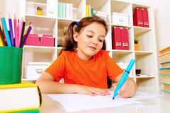 Schoolgirl writing Royalty Free Stock Photography