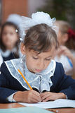 Schoolgirl is writing exercise Royalty Free Stock Images