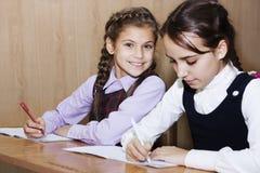 Schoolgirl writing Royalty Free Stock Photography