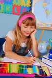 Schoolgirl writing in notebook Royalty Free Stock Photography