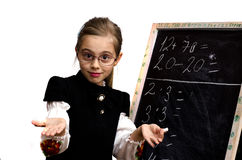 Schoolgirl wrote on the blackboard. On a white background Stock Image