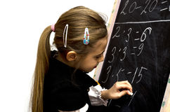 Schoolgirl wrote on the blackboard. On a white background Stock Photo