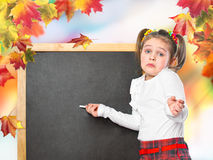 Schoolgirl wrote in chalk on the chalk board Royalty Free Stock Photography