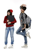 Schoolgirls. Two friends with a backpack and a book posing Stock Image