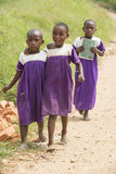 Schoolgirls in Africa barfoot with school uniform Royalty Free Stock Images
