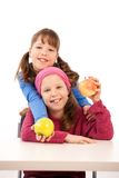 Schoolgirls with apples Stock Photo