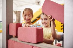 Schoolgirls building with toy bricks, close up royalty free stock photo