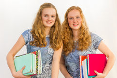 Schoolgirls carrying textbooks Stock Image