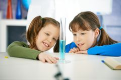 Schoolgirls in chemistry class Royalty Free Stock Images