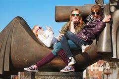 Schoolgirls on a city street Stock Photo