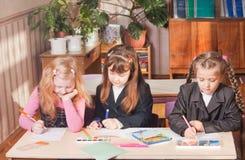 Schoolgirls in classroom Stock Image