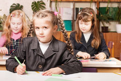 Schoolgirls in classroom Royalty Free Stock Photos