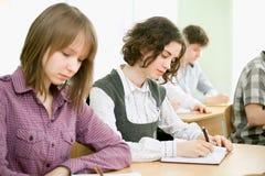 Schoolgirls in the classroom Stock Image