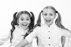 Schoolgirls with cute ponytails hairstyle and brilliant smiles. Best friends excellent pupils. Perfect schoolgirls tidy royalty free stock image