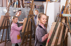 schoolgirls diligently training their painting skills during class at art studio royalty free stock photo