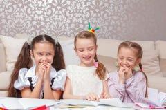 Schoolgirls do home tasks together Royalty Free Stock Photo