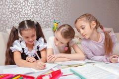 Schoolgirls do home tasks together Stock Image