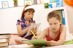 Schoolgirls doing homework Stock Photos