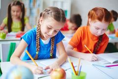 Schoolgirls at drawing lesson Stock Photography