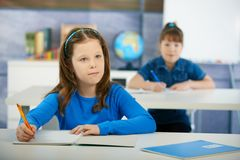 Schoolgirls in elementary school classroom Royalty Free Stock Images