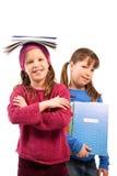 Schoolgirls with exercise books royalty free stock photo