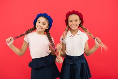 Schoolgirls french little kids smiling face posing hat red background. How to wear french beret. Beret style inspiration. How to wear beret like fashion girl stock photo