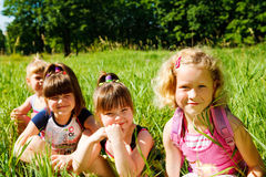 Schoolgirls in grass Royalty Free Stock Photos