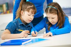 Schoolgirls learning in classroom Royalty Free Stock Images