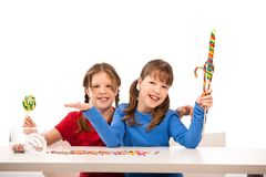 Schoolgirls with lsweets Royalty Free Stock Photography