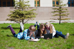 Schoolgirls lying on a grass Royalty Free Stock Photo