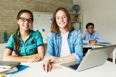 Schoolgirls in Modern Classroom royalty free stock images