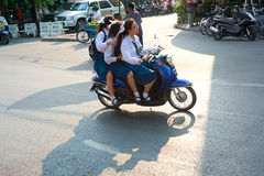 Schoolgirls on motorbike Royalty Free Stock Image